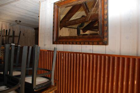 Corrugated metal wainscot for interior