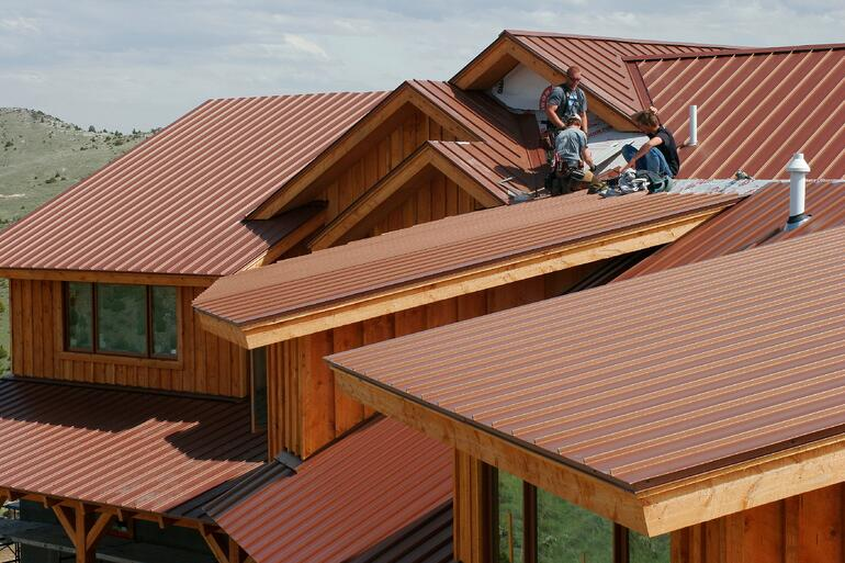 roofers_install_new_metal_roof.jpg