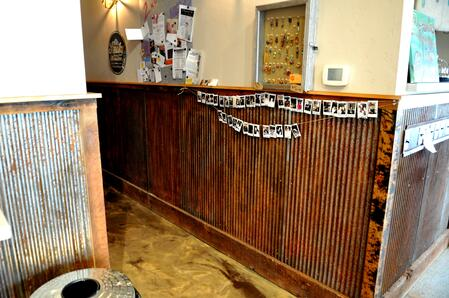 Rusted corrugated metal wainscot